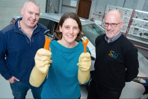 Andy Latham Salvage Wire (R) demonstrates best practice in safe handling of hybrid and electric cars to Brian Nixon CIT and Elena Wrelton ELVES at CIT