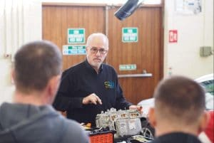 Andy Latham Salvage Wire demonstrates best practice in safe handling of hybrid and electric cars to Electric ELVES attendees at Plunket College